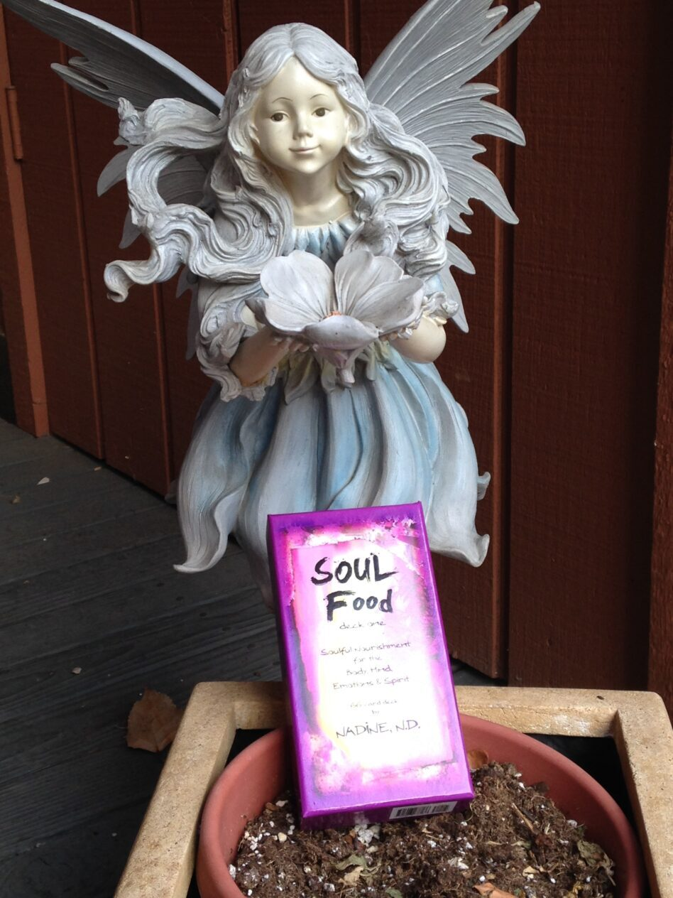 Angel statue looking over a deck of SOUL Food